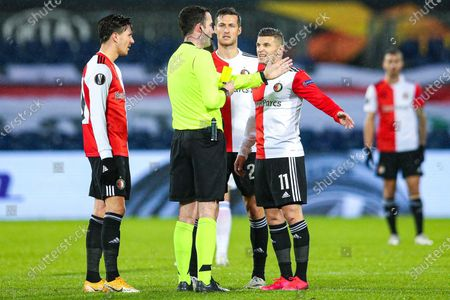 Referee Christopher Kavanagh gives a yellow cart to Uros Spajic (C) of Feyenoord Rotterdam during the UEFA Europa League group K soccer match between Feyenoord Rotterdam and Dinamo Zagreb at the Kuip in Rotterdam, The Netherlands, 03 December 2020.