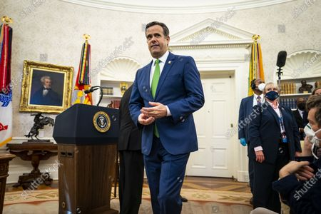 Director of National Intelligence John Ratcliffe walks out of the Oval Office after President Donald Trump presented the Medal of Freedom award in the Oval Office of the White House in Washington, DC,.