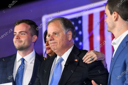 Stock Photo of Sen. Doug Jones, R-Alabama, becomes emotional near the end of his concession speech during his election night watch party in Birmingham, Ala. President-elect Joe Biden is eyeing several Democrats who lost congressional reelection races last month for key positions in his administration. They include outgoing Reps. Abby Finkenauer of Iowa and Donna Shalala of Florida and Sen. Doug Jones of Alabama