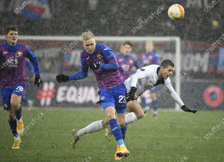Stock Photo of Hordur Bjorgvin Magnusson (C) of CSKA Moscow in action against Dejan Joveljic (R) of Wolfsberg during the UEFA Europa League goup K soccer match between CSKA Moscow and Wolfsberger AC in Moscow, Russia, 03 December 2020.