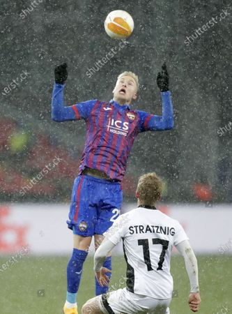 Stock Picture of Hordur Bjorgvin Magnusson (up) of CSKA Moscow in action against Kai Stratznig (bottom) of Wolfsberg during the UEFA Europa League goup K soccer match between CSKA Moscow and Wolfsberger AC in Moscow, Russia, 03 December 2020.