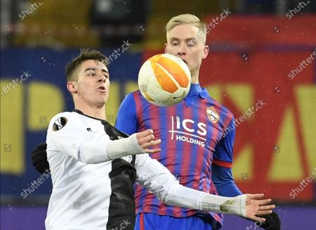 Hordur Bjorgvin Magnusson (R) of CSKA Moscow in action against Dario Vizinger (L) of Wolfsberg during the UEFA Europa League goup K soccer match between CSKA Moscow and Wolfsberger AC in Moscow, Russia, 03 December 2020.