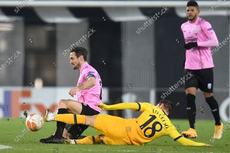 Tottenham's Giovani Lo Celso, right, challenges for the ball with LASK's James Holland during the Europa League Group J soccer match between Linzer ASK and Tottenham Hotspur at the Linzer stadium in Linz, Austria