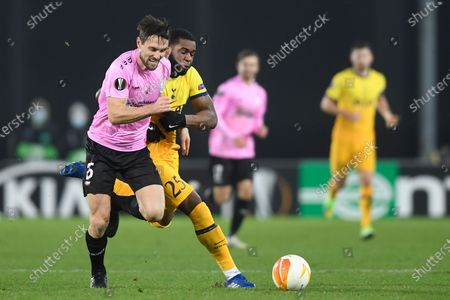 Tottenham's Japhet Tanganga, right, challenges for the ball with LASK's James Holland during the Europa League Group J soccer match between Linzer ASK and Tottenham Hotspur at the Linzer stadium in Linz, Austria