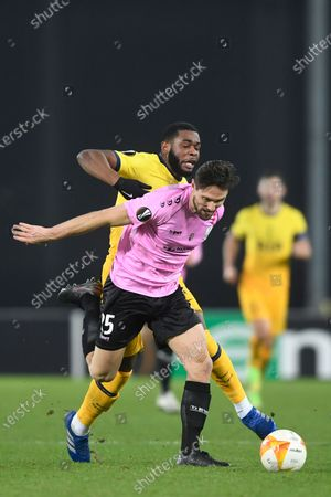 Stock Image of Tottenham's Japhet Tanganga, right, challenges for the ball with LASK's James Holland during the Europa League Group J soccer match between Linzer ASK and Tottenham Hotspur at the Linzer stadium in Linz, Austria