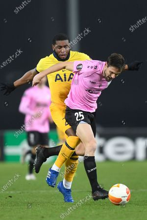 Stock Photo of Tottenham's Japhet Tanganga, left, challenges for the ball with LASK's James Holland during the Europa League Group J soccer match between Linzer ASK and Tottenham Hotspur at the Linzer stadium in Linz, Austria