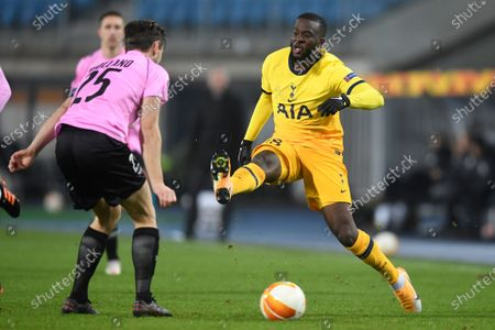 Tottenham's Tanguy Ndombele challenges for the ball with LASK's James Holland during the Europa League Group J soccer match between Linzer ASK and Tottenham Hotspur at the Linzer stadium in Linz, Austria