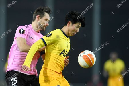 Tottenham's Son Heung-min challenges for the ball with LASK's James Holland during the Europa League Group J soccer match between Linzer ASK and Tottenham Hotspur at the Linzer stadium in Linz, Austria