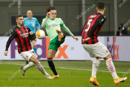 Celtic's Diego Laxalt, center, is challenged by AC Milan's Rade Krunic, left, and AC Milan's Diogo Dalot during the Europa League, Group H, soccer match between AC Milan and Celtic at the San Siro Stadium, in Milan, Italy