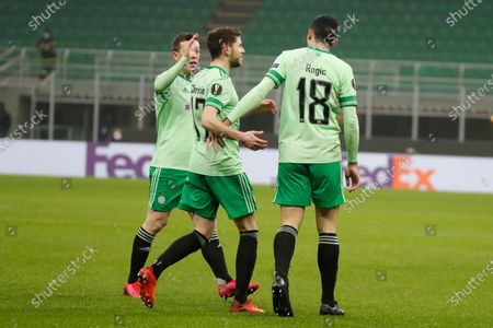 Celtic's Tom Rogic, right, celebrates with his teammates after scoring his side's opening goal during the Europa League, Group H, soccer match between AC Milan and Celtic at the San Siro Stadium, in Milan, Italy