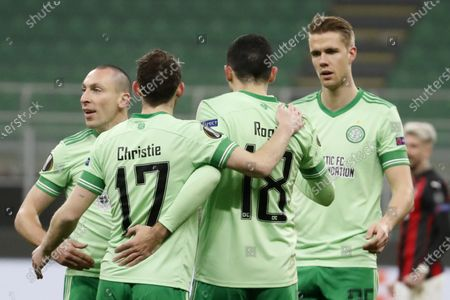 Celtic's Tom Rogic, second right, celebrates with his teammates after scoring his side's opening goal during the Europa League, Group H, soccer match between AC Milan and Celtic at the San Siro Stadium, in Milan, Italy