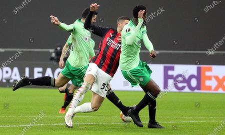 Celtic's Tom Rogic (L) scores the first goal for his team during the UEFA Europa League Group H soccer match AC Milan vs Celtic at Giuseppe Meazza stadium in Milan, Italy, 03 December 2020.