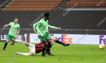 Celtic's Tom Rogic (partially hidden) scores the first goal for his team during the UEFA Europa League Group H soccer match AC Milan vs Celtic at Giuseppe Meazza stadium in Milan, Italy, 03 December 2020.