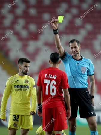 Stock Picture of Sivasspor's Faycal Fajr (C) is booked by Croatian referee Dude Strukan (R) during the UEFA Europa League Group I soccer match between Sivasspor and Villarreal CF in Sivas, Turkey, 03 December 2020.