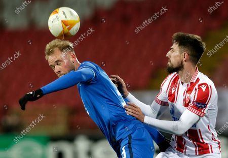 Hoffenheim's Klauss (L) in action with Red Star's Milos Degenek (R) during the UEFA Europa League, group L match, between Red Star and Hoffenheim in Belgrade, Serbia, 03 December 2020.