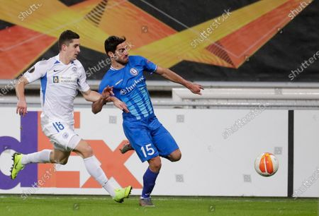 Milad Mohammadi (R) of Gent and Martin Koscelnik (L) of Liberec in action during the UEFA Europa League group L soccer match between KAA Gent and FC Slovan Liberec in Gent, Belgium, 03 December 2020.