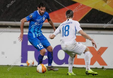 Milad Mohammadi (L) of Gent and Martin Koscelnik (R) of Liberec in action during the UEFA Europa League group L soccer match between KAA Gent and FC Slovan Liberec in Gent, Belgium, 03 December 2020.