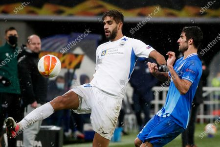 Milad Mohammadi (R) of Gent and Abdulla Yusuf Helal (L) of Liberec in action during the UEFA Europa League group L soccer match between KAA Gent and FC Slovan Liberec in Gent, Belgium, 03 December 2020.
