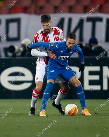 Stock Photo of Hoffenheim's Mijat Gacinovic, right, duels for the ball with Red Star's Milos Degenek during the Europa League group L soccer match between Red Star and Hoffenheim at the Rajko Mitic Stadium in Belgrade, Serbia