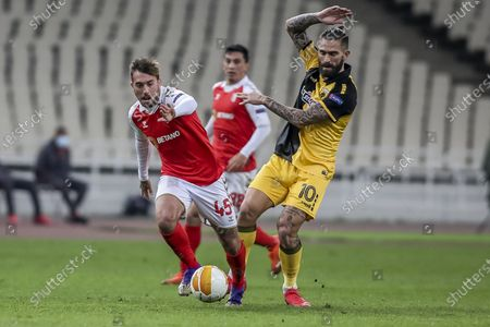 Stock Image of AEK's Marco Livaja (R) vies for the ball with Braga's Iuri Medeiros during the UEFA Europa League Group G soccer match AEK vs Braga at OAKA in Athens, Greece, 03 December 2020.