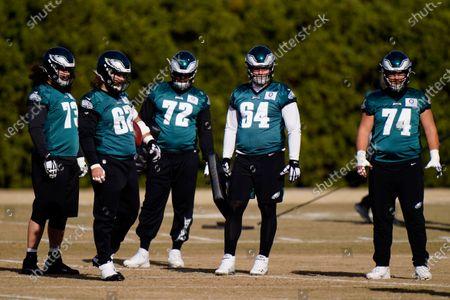 Philadelphia Eagles' Isaac Seumalo (73), Jason Kelce (62), Prince Tega Wanogho (72), Brett Toth (64) and Luke Juriga (74) gather on the field during practice at the NFL football team's training facility, in Philadelphia