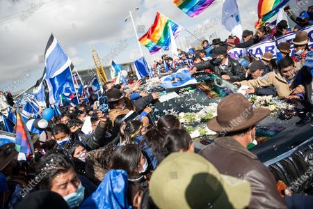 Hundreds of supporters surround at the airport of El Alto the car of former Bolivian president Evo Morales. He resigned on November 10th 2019 in the midst of a severe political crisis.