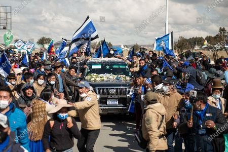 Hundreds of supporters surround at the airport of El Alto the car of former Bolivian president Evo Morales. The security had severe problems to open up a path for the vehicle. Evo Morales resigned on November 10th 2019 in the midst of a severe political crisis.