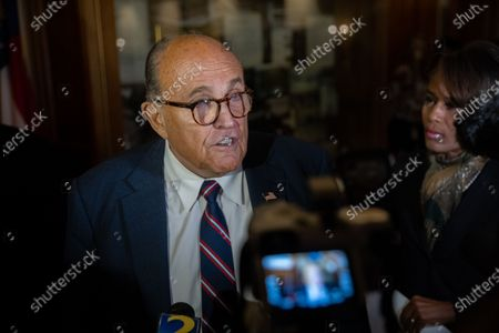 President Trump's lawyer, and former New York Mayor, Rudy Giuliani is seen inside of the Georgia State Capitol in Atlanta, Georgia after an election hearing on December 3rd.