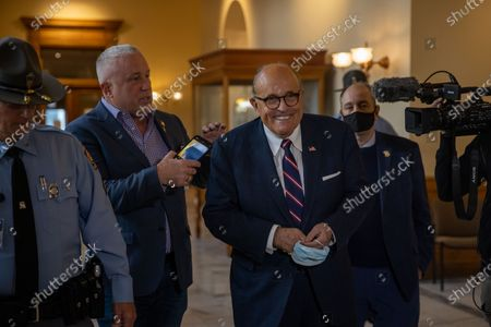 President Trump's lawyer, and former New York Mayor, Rudy Giuliani is seen inside of the Georgia State Capitol in Atlanta, Georgia on break during an election hearing on December 3rd.