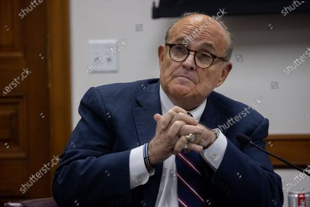President Trump's lawyer, and former New York Mayor, Rudy Giuliani is seen inside of the Georgia State Capitol in Atlanta, Georgia during an election hearing on December 3rd.