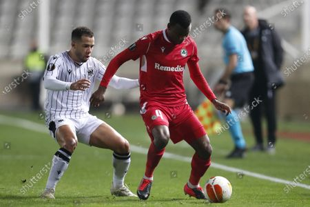 Stock Picture of Omonia's Shehu Abdullahi, right, fights for the ball with PAOK's Rodrigo Soares during the Europa League group E soccer match between Omonia and PAOK at GSP stadium in Nicosia, Cyprus