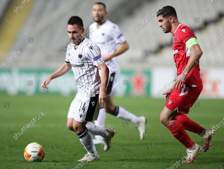 Andrija Zivkovic (L) of PAOK in action against Ioannis Kousoulos (R) of Omonoia Nicosia during the UEFA Europa League group E soccer match between Omonoia Nicosia and PAOK FC at the GSP stadium in Nicosia, Cyprus, 03 December 2020.