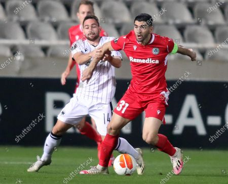 Stock Picture of Ioannis Kousoulos (R) of Omonoia Nicosia in action against Andrija Zivkovic (L) of PAOK during the UEFA Europa League group E soccer match between Omonoia Nicosia and PAOK FC at the GSP stadium in Nicosia, Cyprus, 03 December 2020.