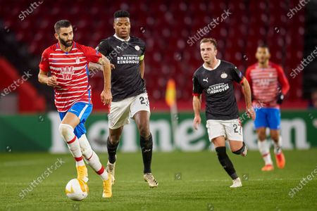 Maxime Gonalons of Granada CF, Denzel Dumfries and Mario Gotze of PSV Eindhoven
