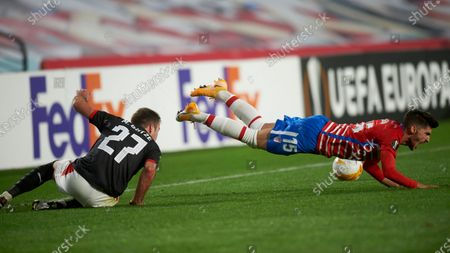 Carlos Neva of Granada CF and Mario Gotze of PSV Eindhoven