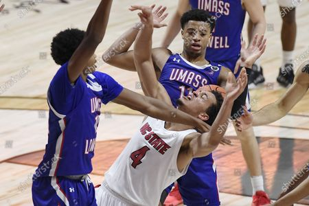 Stock Photo of UMass-Lowell's Max Brooks, left, fouls North Carolina State's Jericole Hellems during the first half of an NCAA college basketball game, in Uncasville, Conn