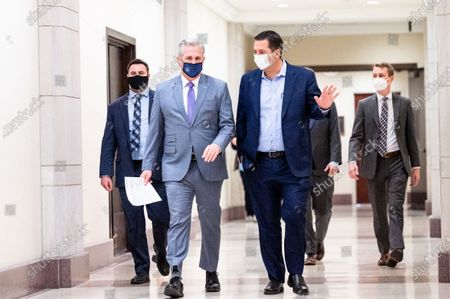 Stock Photo of House Minority Leader Kevin McCarthy (R-CA) speaks with U.S. Representative Devin Nunes (R-CA) as he walks towards his weekly press conference.
