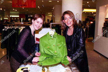 Editorial photo of Helen Baxendale Takes Her Purchase To The Till Which Is Being Looked After By Faye Ripley At A Selfridges Celebrity Shopping Evening On Behalf Of The Terrence Higgins Trust.