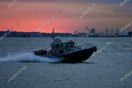 A NYPD patrol boat in New York Harbor as seen from Louis Valentino, Jr. Park in the Red Hook neighborhood of Brooklyn.