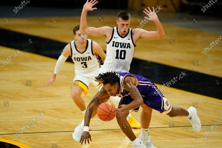 Western Illinois guard Anthony Jones is fouled by Iowa guard Joe Wieskamp (10) during the first half of an NCAA college basketball game, in Iowa City, Iowa