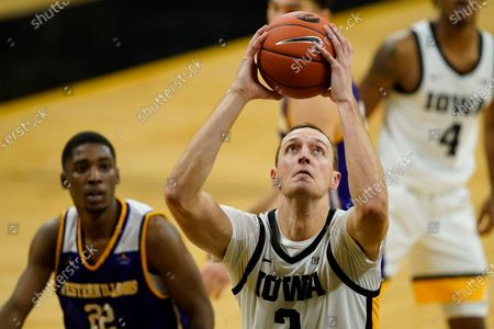 Iowa forward Jack Nunge drives to the basket ahead of Western Illinois guard Marcus Watson Jr., left, during the second half of an NCAA college basketball game, in Iowa City, Iowa