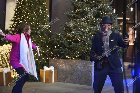 """Hoda Kotb (left) and Al Roker host """"Christmas in Rockefeller Center"""" during the 88th Rockefeller Center Christmas Tree Lighting Ceremony, in New York. The lit tree will be on display starting Thursday, December 3, through early January 2021 and will also will be livestreamed each day from 8 am to midnight at rockefellercenter.com"""