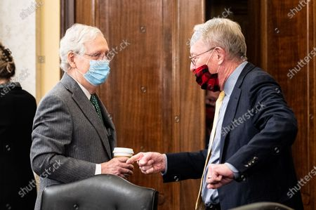 Senate Majority Leader Mitch McConnell (R-KY) speaks with U.S. Senator Lamar Alexander (R-TN) at a meeting of the Senate Rules and Administration Committee.