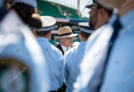 Australian Prime Minister Scott Morrison speaks with police officers after a police Attestation Parade at the Sydney Cricket Ground in Sydney, Australia, 04 December 2020.
