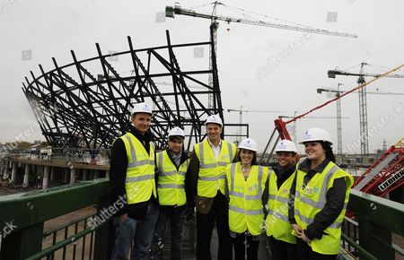 Editorial photo of The Daily Mail Magnificent 7 Annual Get Together At The London 2012 Site At Stratford. Sir Steve Redgrave With L-r Giles Scott Louis Smith Emile Pidgeon Tom Daley And Rachel Latham Infront Of The New Athletics Stadium - Gold Fever In The East End - O
