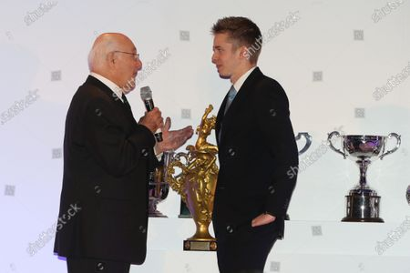 Grand Connaught Rooms, London, England. 3rd December 2012. The Woolf Barnato Trophy winner, Alex Brundle with Murray Walker. World Copyright: Jakob Ebrey/LAT Photographic