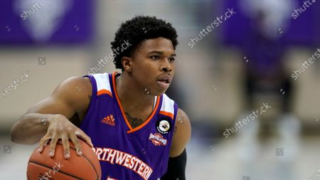 Northwestern State guard Brian White handles the ball during an NCAA college basketball game against TCU in Fort Worth, Texas