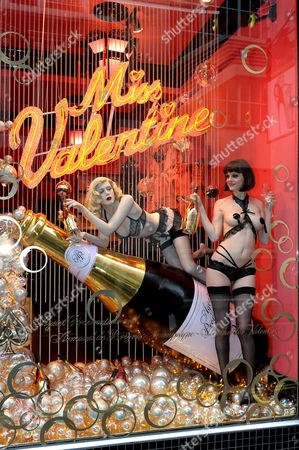 Editorial picture of Model Jen Dawson in the window of Agent Provocateur wearing a playsuit to celebrate Valentines Day. London, Britain  - 12 Feb 2010