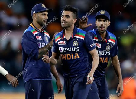 India's Deepak Chahar, center, is congratulated after taking the wicket of Australia's Moises Henriques during their T20 international cricket match at Manuka Oval, in Canberra, Australia