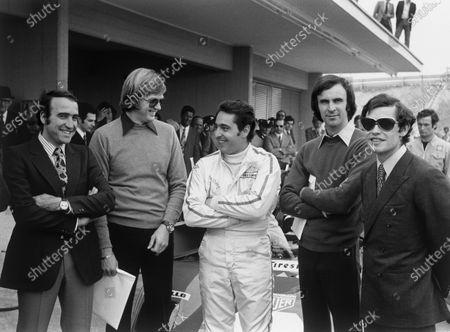 Fiorano Circuit, Maranello, Italy. L to R: Ferrari drivers Clay Regazzoni, Ronnie Peterson, Peter Schetty Tim Schenken and Jacky Ickx, pictured here at the opening of Fiorano, Ferrari's private test track, portrait. World Copyright: LAT Photographic. Ref:  4381 - 24A-25.